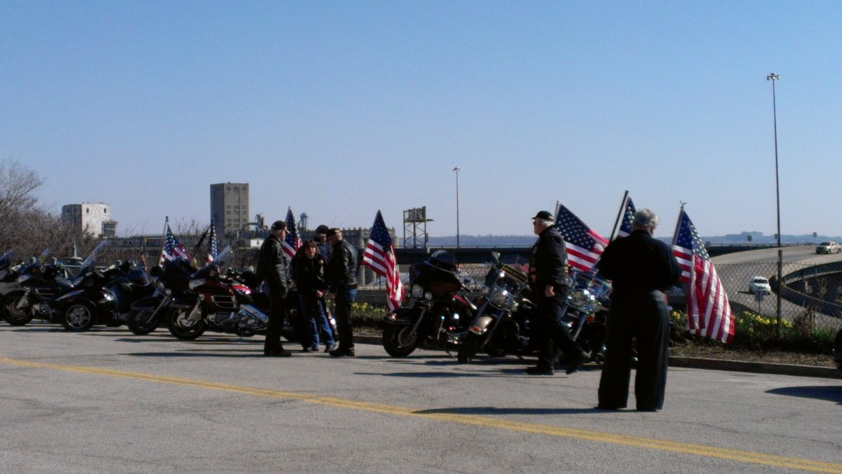 Some Patriot Guard riders carry a flag. They ride in certain positions during the funeral procession.