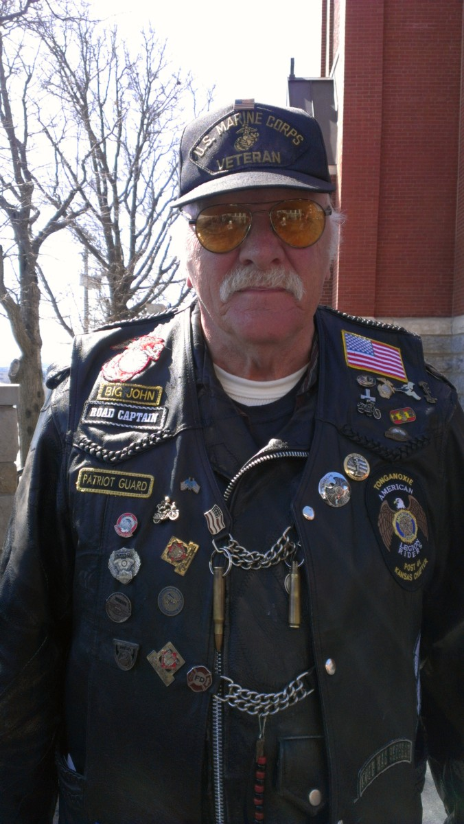 Big John served as a U.S. Marine. He is a member of the American Legion and rides with the Patriot Guard. He helped me understand the Patriot Guard's history. Notice the M-16 bullet and shell on his vest?