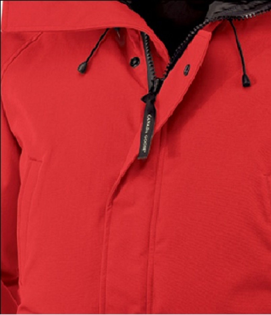 Storm flap that covers buttons and coil zipper