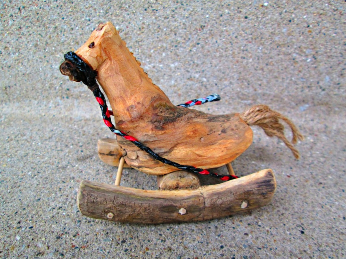 Here I braided the plarn to make reigns for a miniature driftwood rocking horse