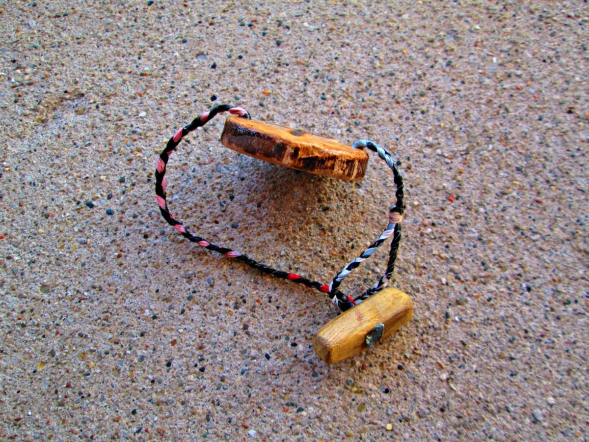 A wood toggle bead and loop, note the wrapped thread finish on this piece