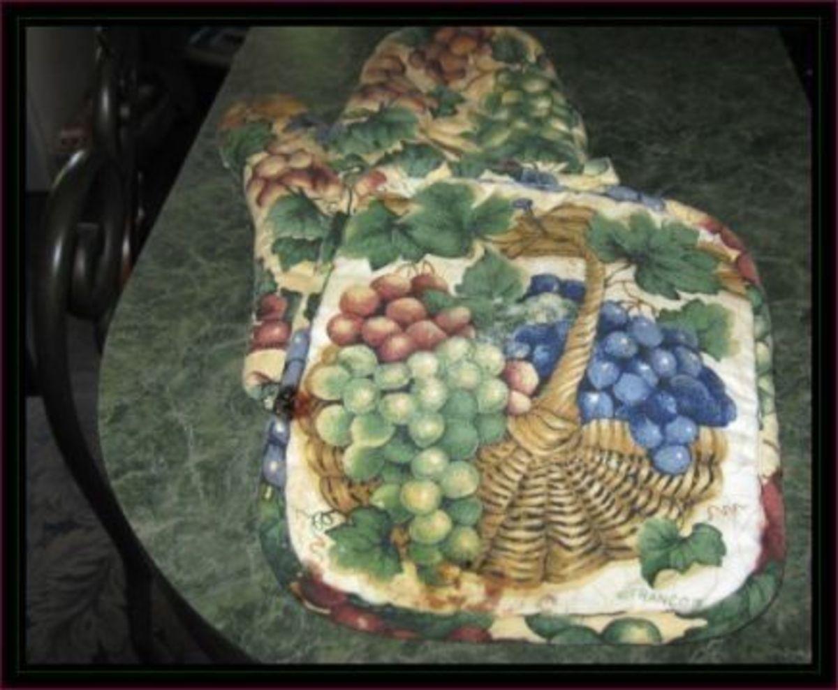 Grape themed hot pads, worn