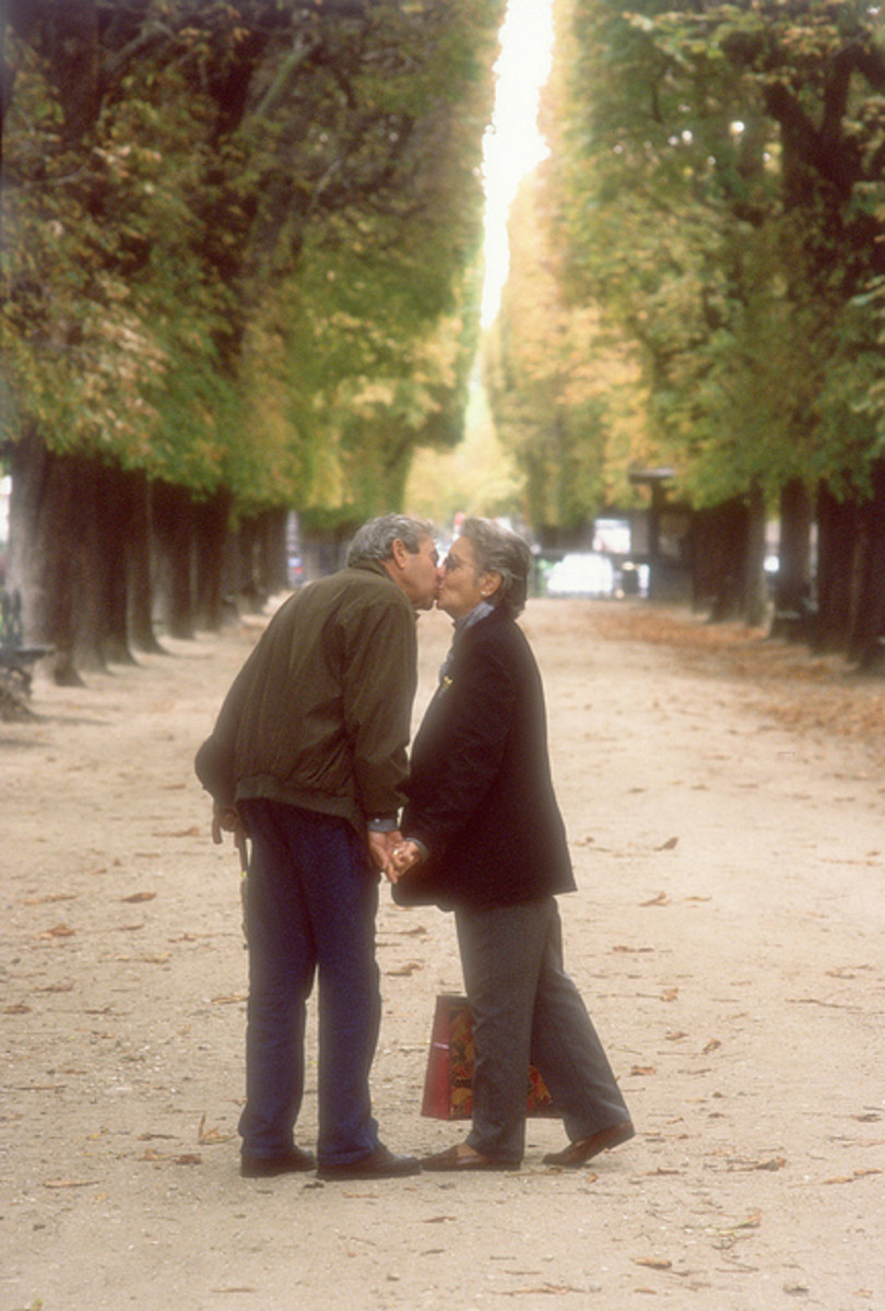 Love has no Age- Old Couple kissing in park