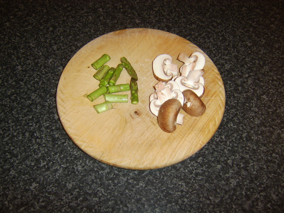 Chopped asparagus and sliced chestnut mushrooms