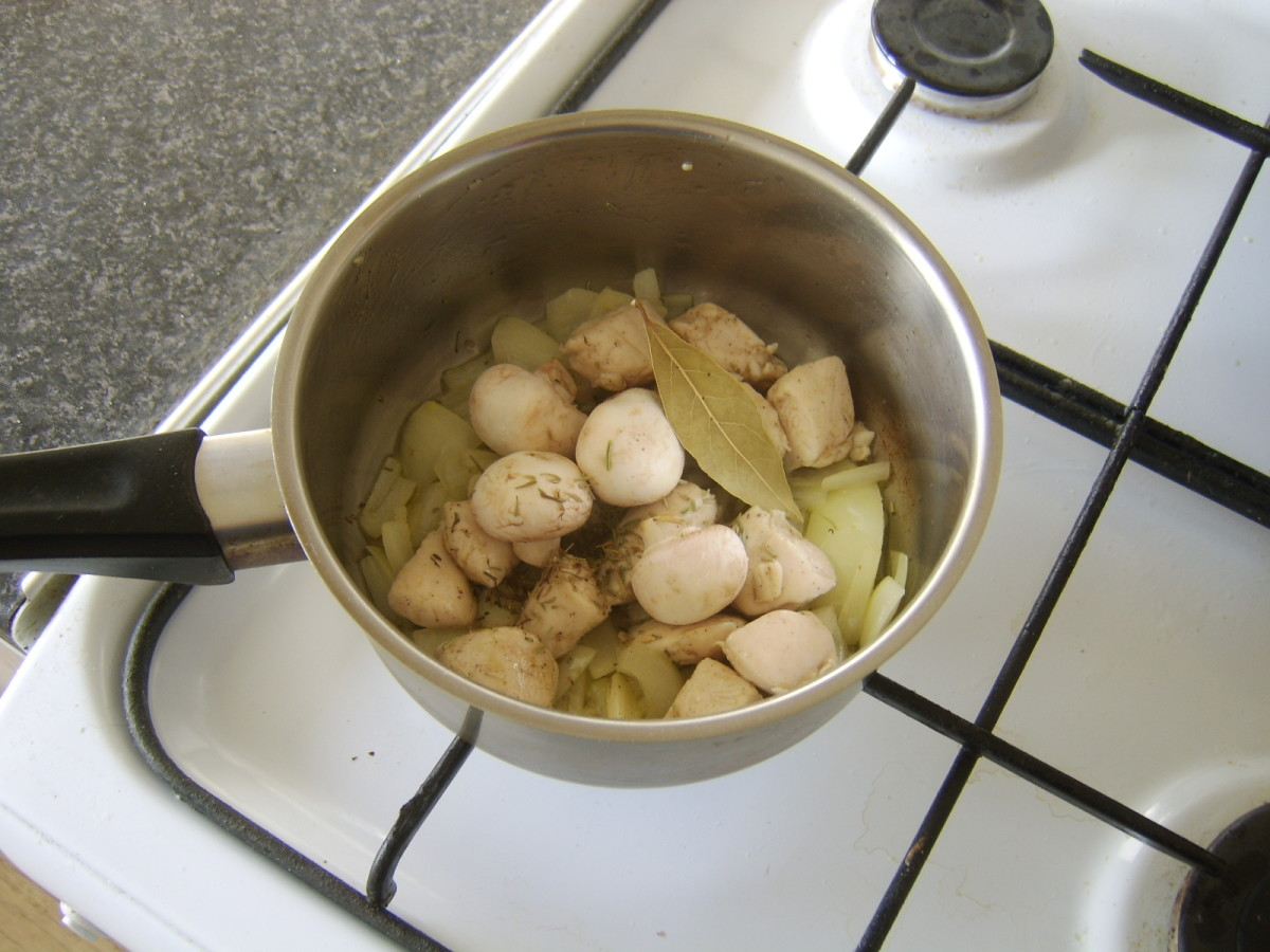 Chicken, mushrooms and herbs are added to softened garlic and onion