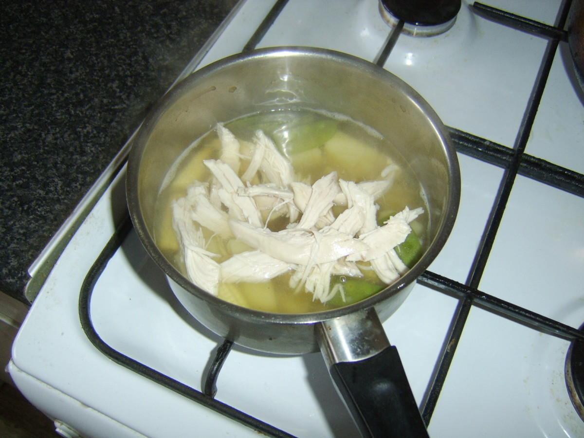 Precooked chicken breast meat is added to soup for last few minutes to heat through