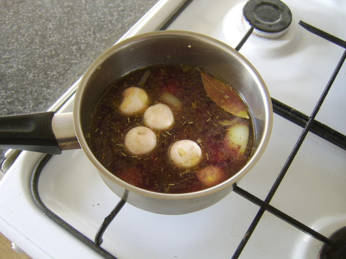Chicken stock and red wine complete the soup's ingredients
