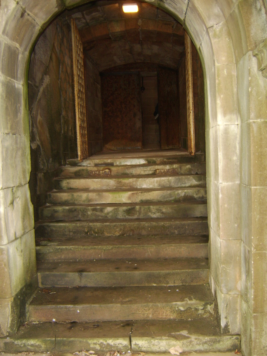 Stone steps lead upwards and in to the crypt in Hamilton Mausoleum