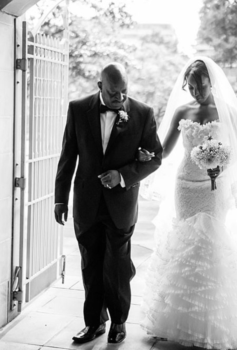 Father In Tuxedo Walking Bride Down Aisle