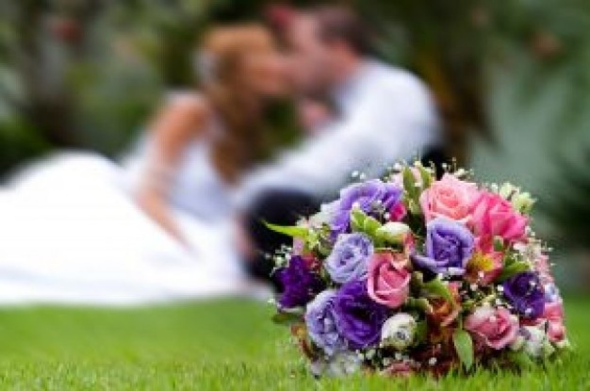 Bridal Bouquet With Bride And Groom In Background
