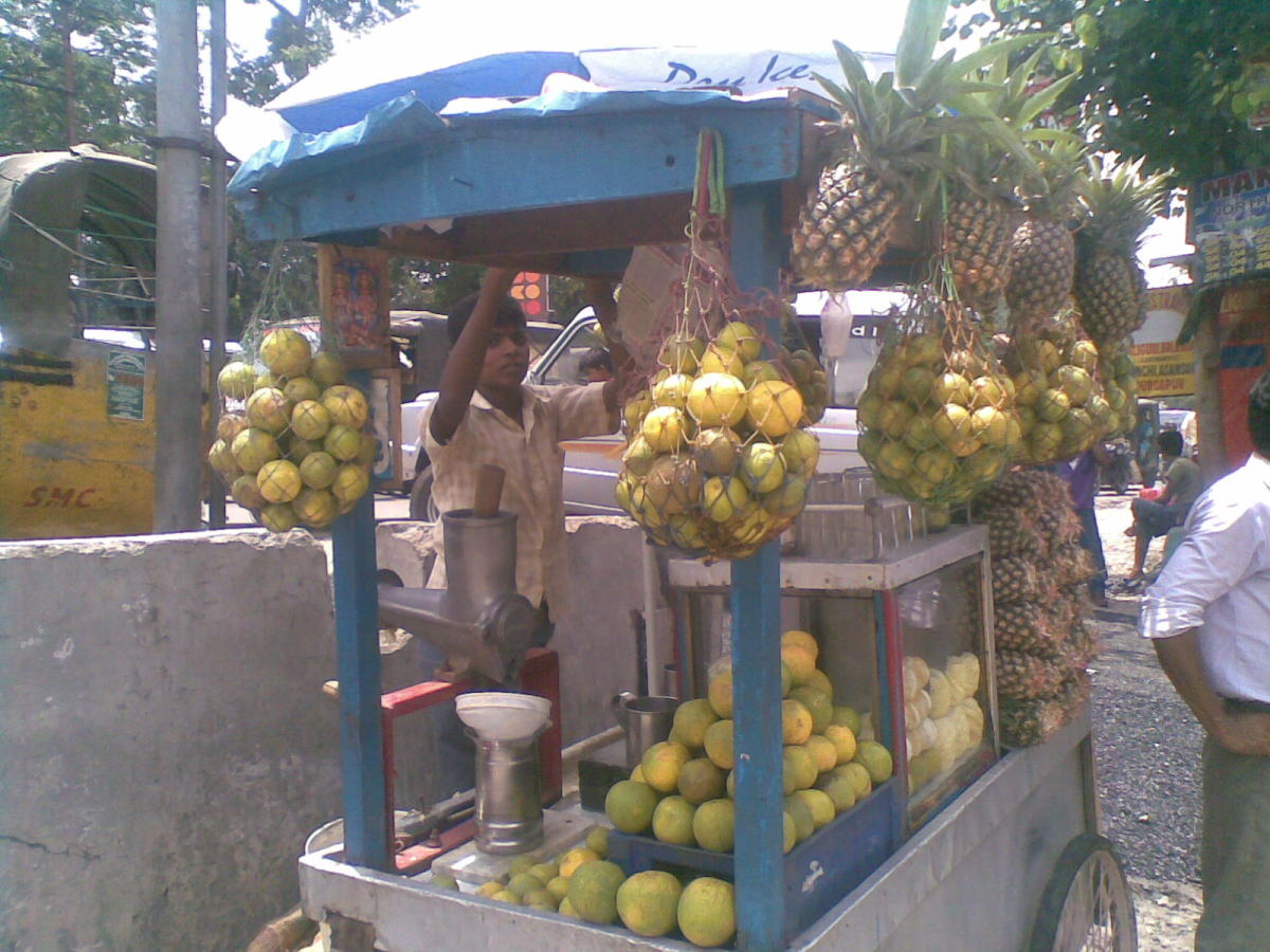 Roadside vendor selling mosambi juice