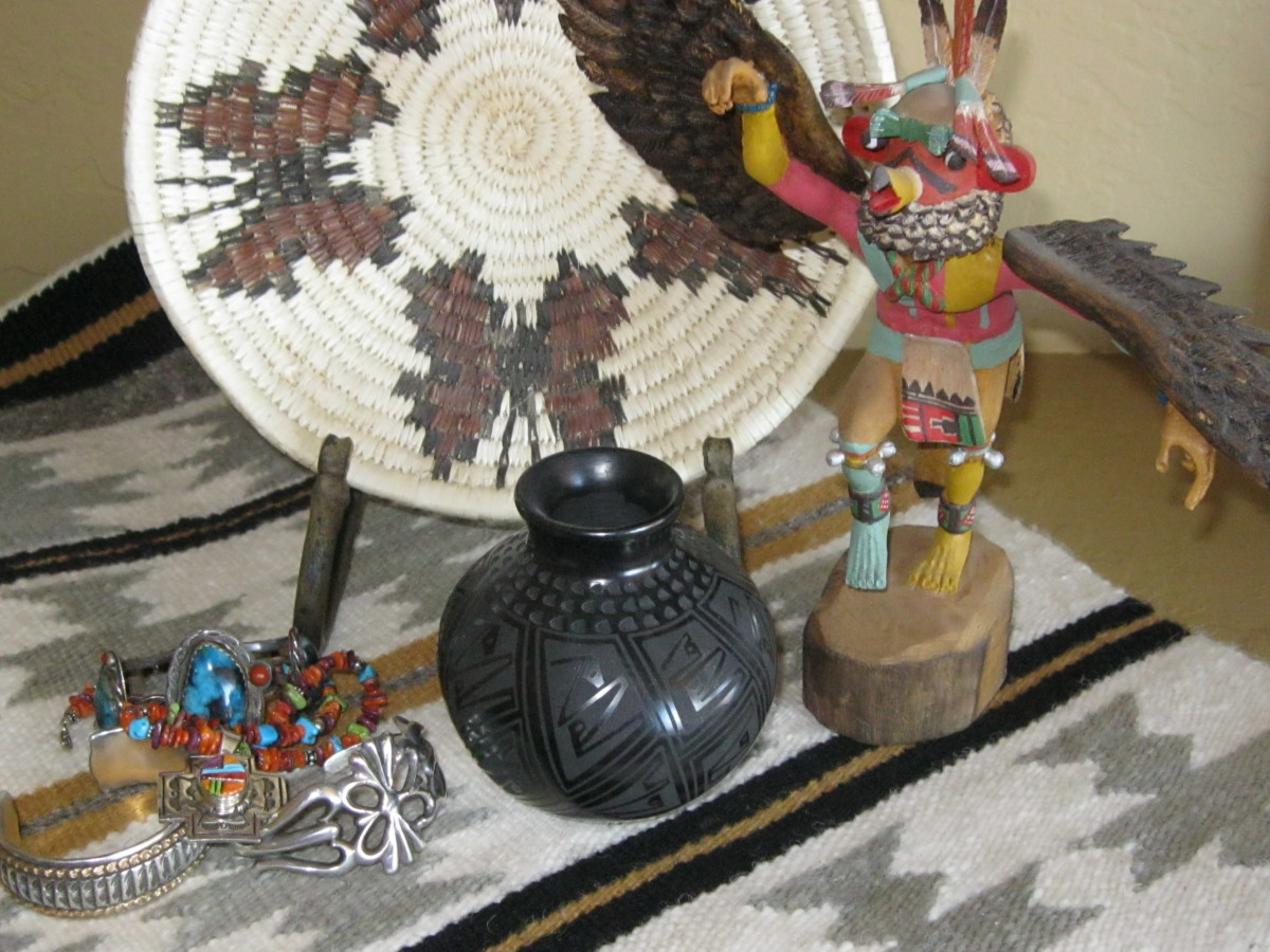 Butterfly basket, Eagle Dancer Kachina, Black Pueblo pot, Crystal pattern Navajo rug, Assorted jewelry
