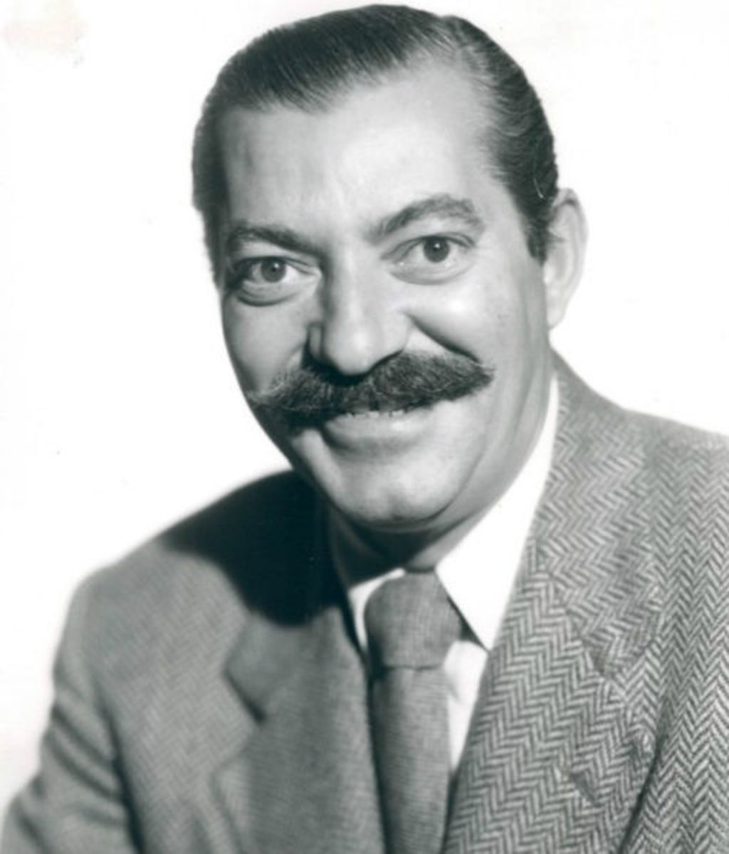 Comedian Jerry Colonna; 1951 in The Jerry Colonna Show on television.