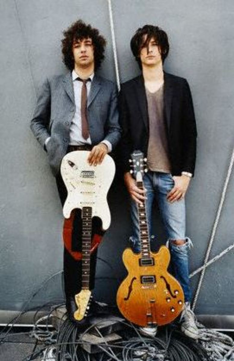 Albert Hammond, Jr. (left) and Nick Valensi are noted users of the MXR Micro Amp. They utilize the pedal to achieve their saturated yet articulate guitar tones that form the foundation of the Strokes' sound.