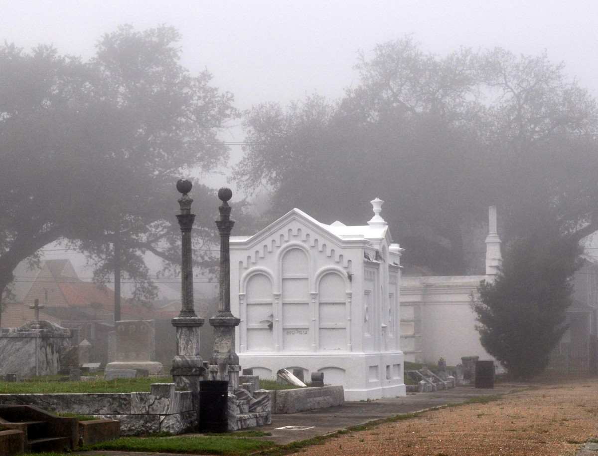 "These in Masonic Cemetery in the fog- all graves here are owned by Masons, many of which are buried by ""Lodge."" The coping style grave in front is the Hiram Lodge 70, the large white tomb is Alpha Home Lodge 72."