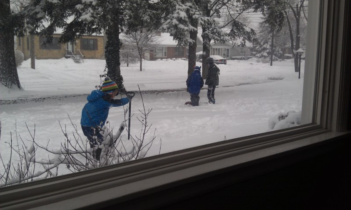 The snow brings colder temperature. No School due to snow butstill warm enough for the kids to play outside
