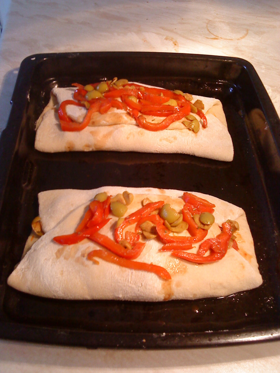 Put rest of pepper mixture on top. Drizzle with oil. Ready for the oven!