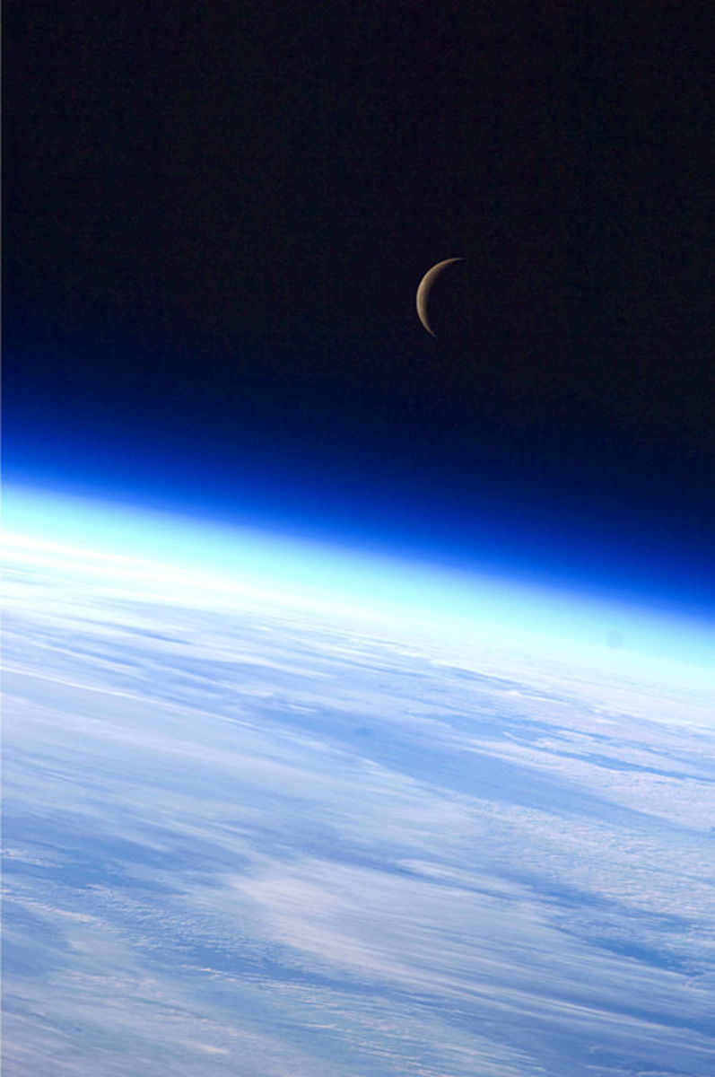 Photo of  the New Moon above planet Earth