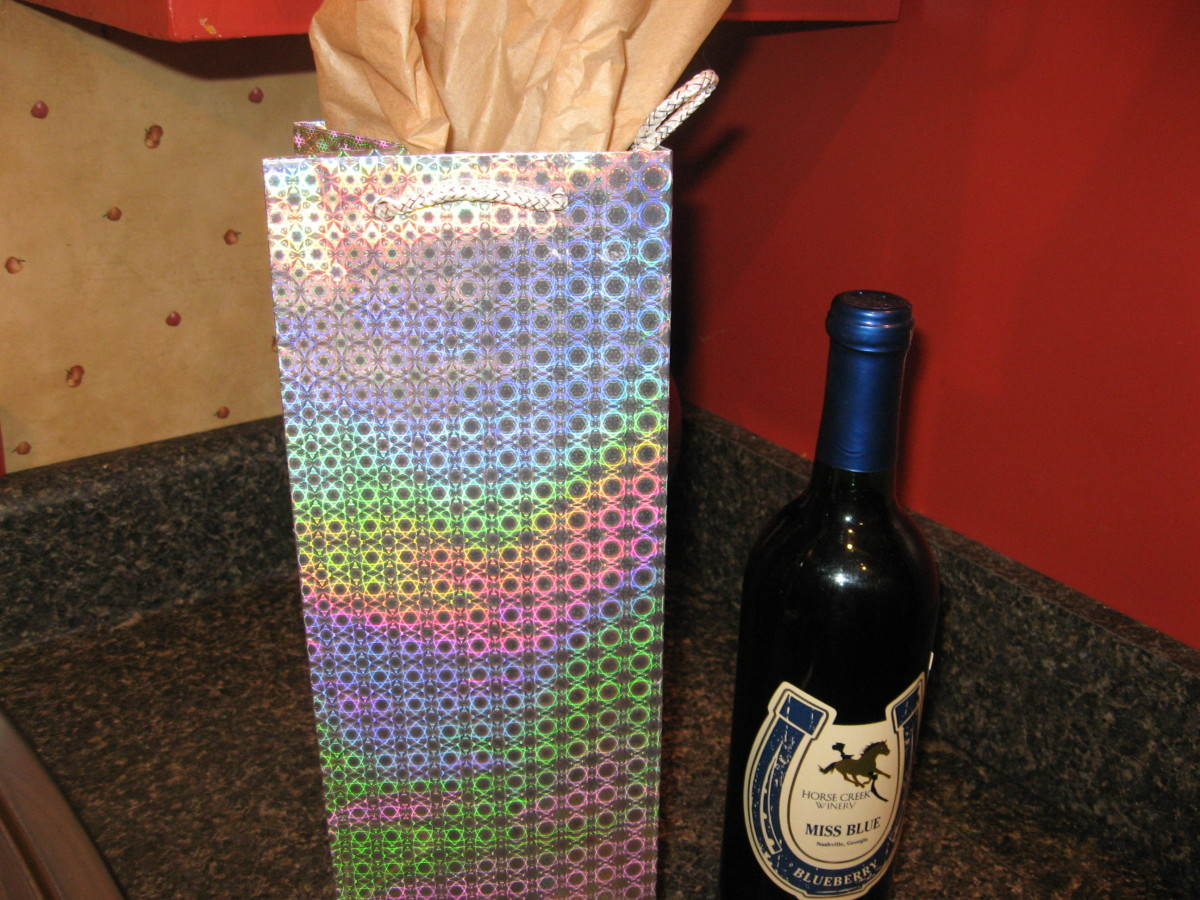 Traditional Housewarming Gifts include bottles of wine.