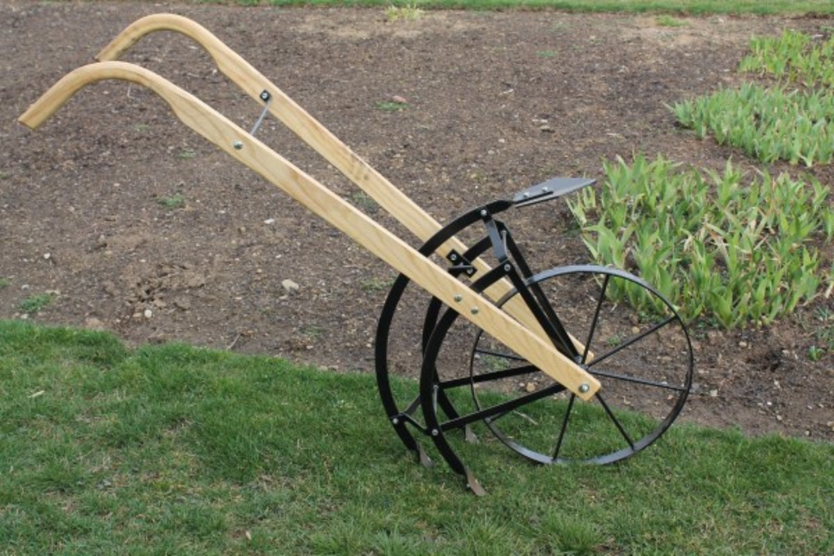 Amish made flip and go cultivator.  Has garden plow on one side and cultivator tangs on the other side.