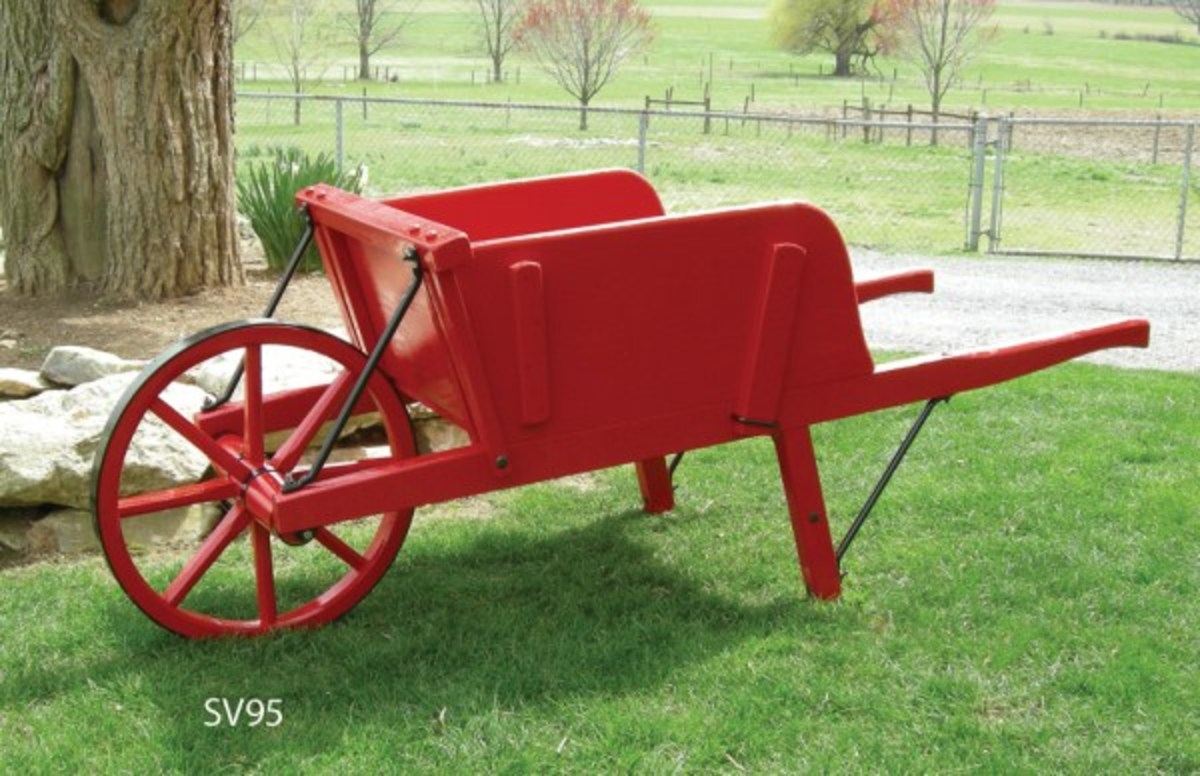 Amish reproduction wheelbarrows.