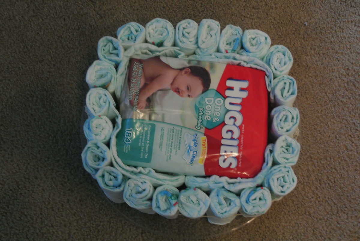 I placed some unrolled diapers in between the rolled diapers and filling (baby wipes) to help round out the base.