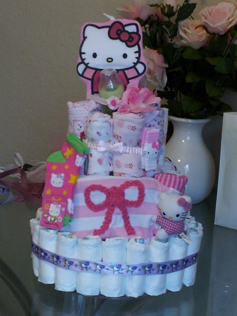 I made this girl, Hello Kitty themed diaper cake for my God daughter.  I put more diapers inside along with wipes and clothes.