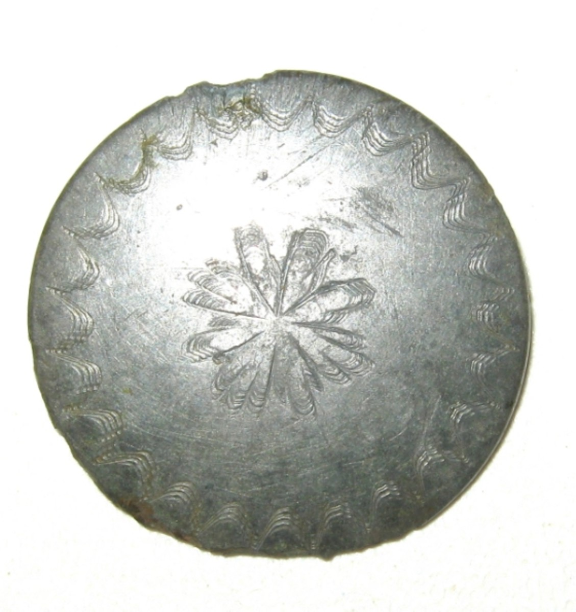 An 18th century Tombac button found on a pasture field.