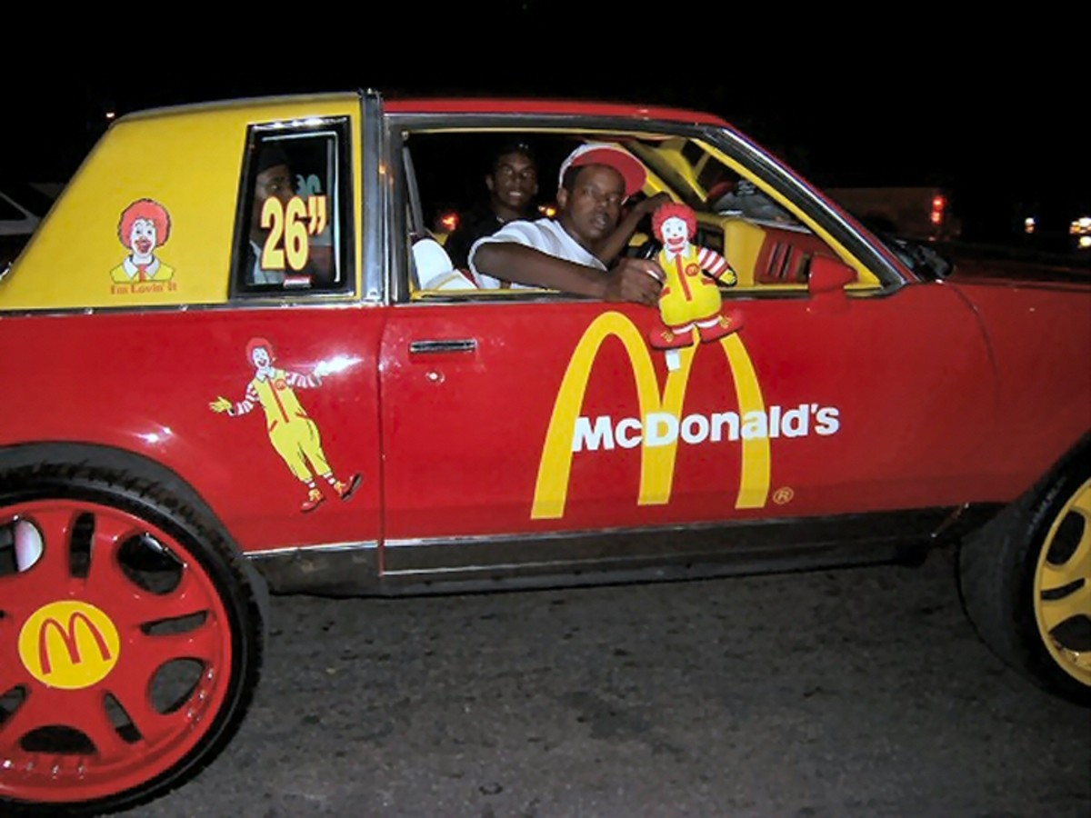 This McDonald's themed Donk is just crazy.  It's painted red and yellow to match the McDonald's theme.  But, those painted wheels are horrible.  Notice how they have to put how big the wheels are on the window.
