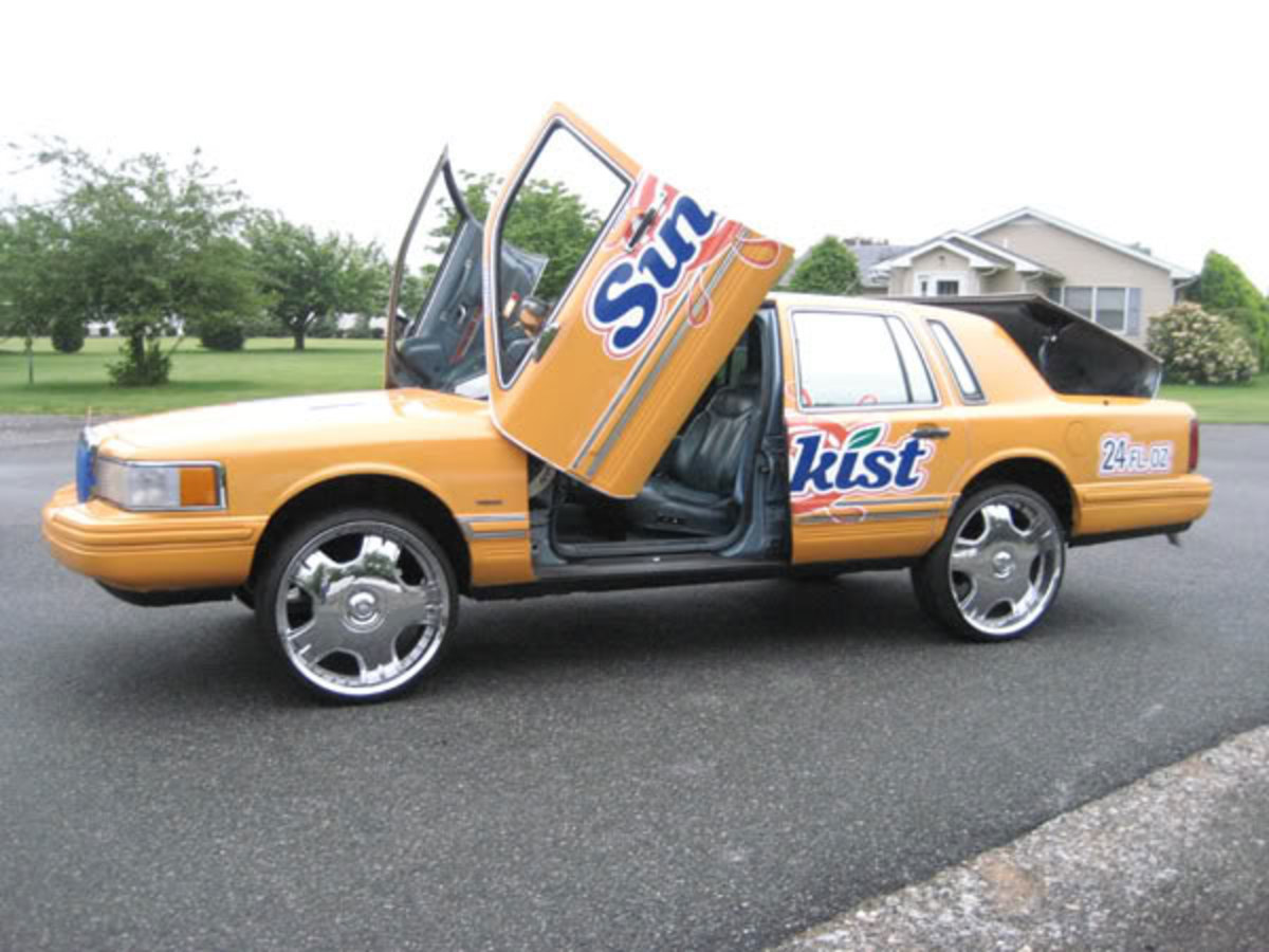 This Sunkist themed Donk is not horrible.  However, the Lamborghini doors are ridiculous.