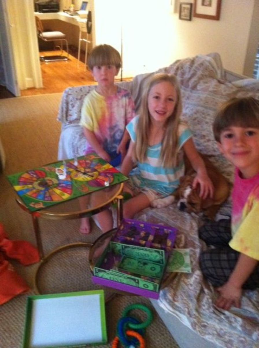Three of the grandkids playing Money Bags A Coin Value Game