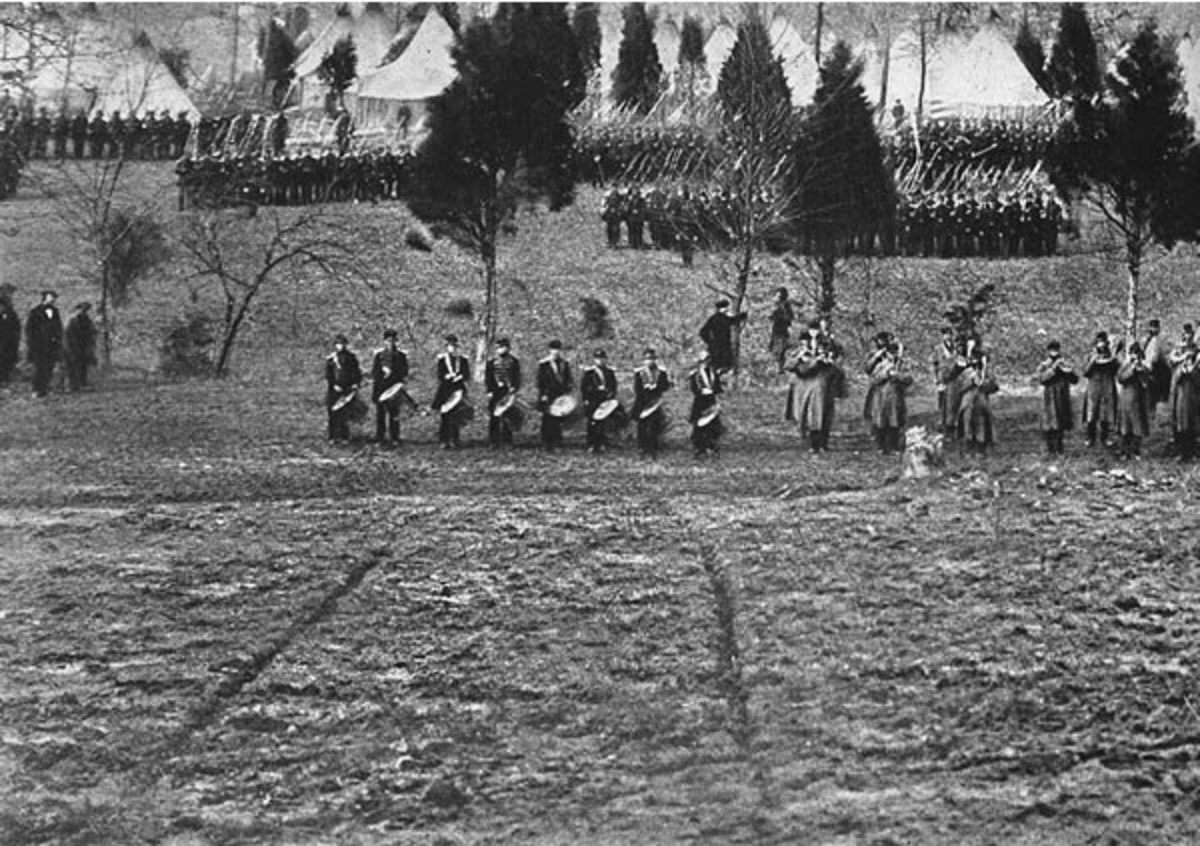 A Regimental Band prepares to play as the Regiment forms up behind them.