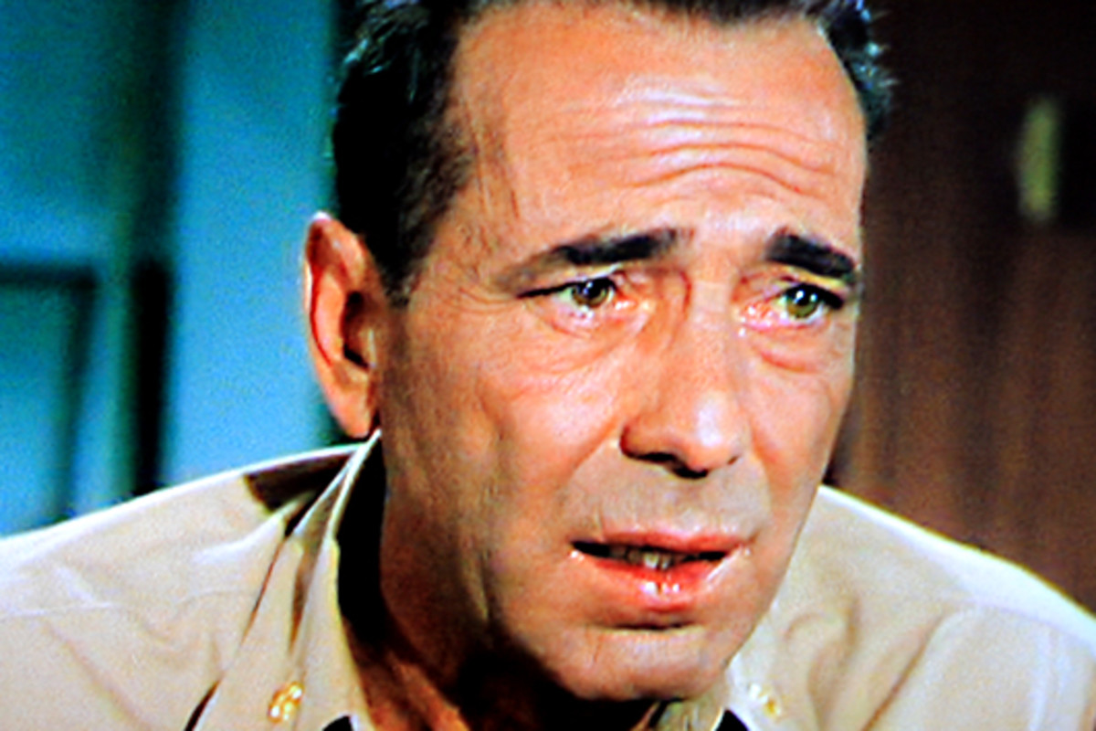 The face of Captain Queeg as he squirms in front of his officers as he speaks to them