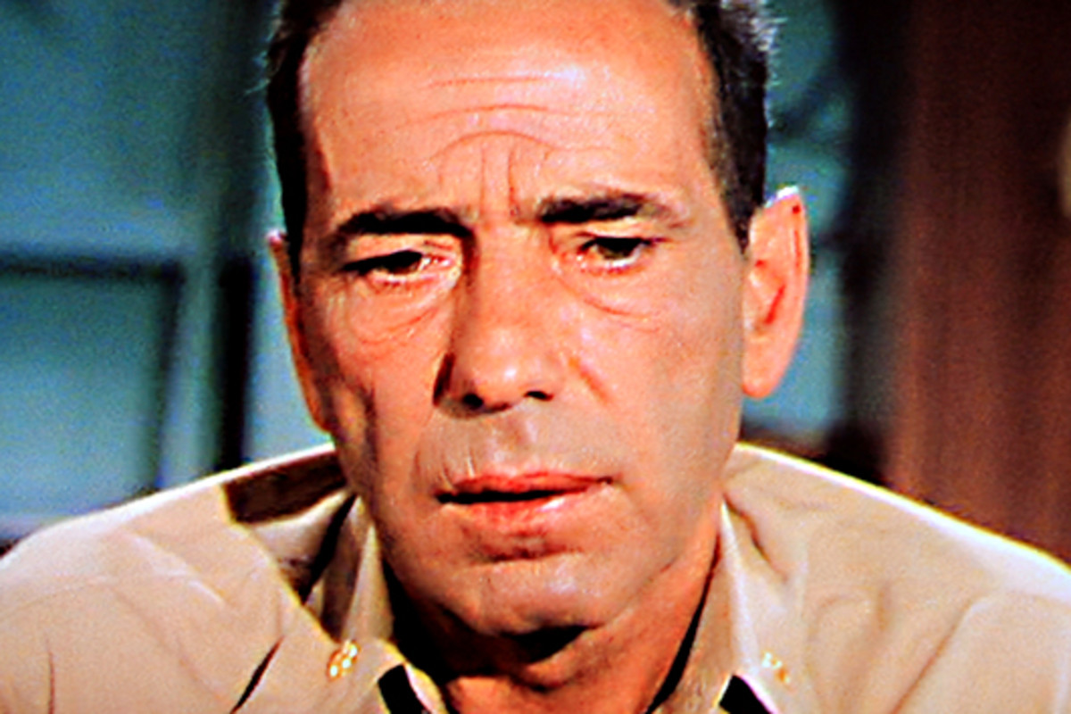 Captain Queeg addresses his officers, but his mind seems to be vague and wandering