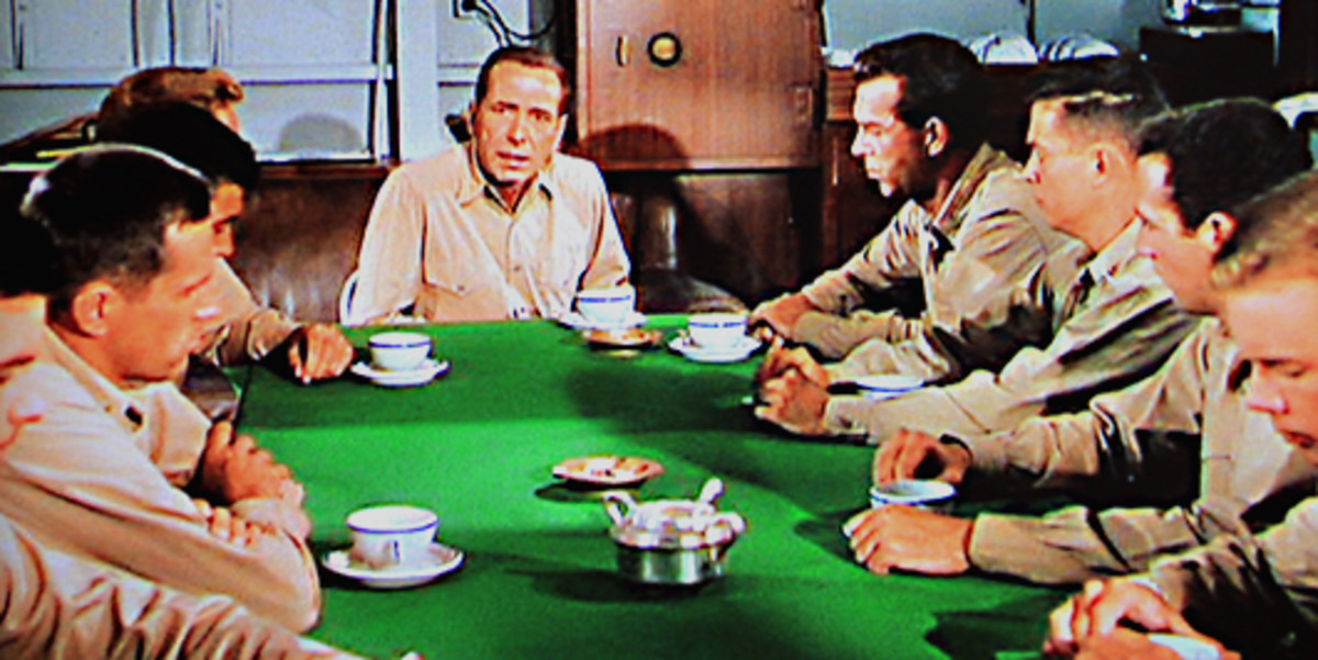 Captain Queeg chairs an uncomfortable and embarrassing meeting of his senior officers