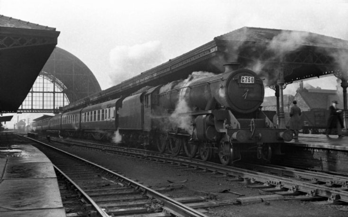Race Special from BR Midland Region behind an unidentifiable 'Black Five' (Class 5 4-6-0)  stands at Middlesbrough Station pre-1954 (remainder of overall roof still in situ)
