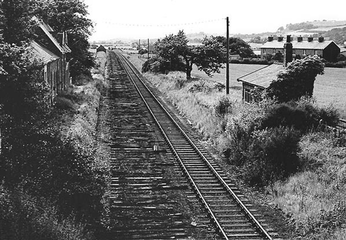 Pinchinthorpe Station in June, 1965, over a year after the closure to passengers, not long before rails are lifted. Trackbed is now a public footpath and station building is a private residence. There's a brick waiting shelter on the down platform