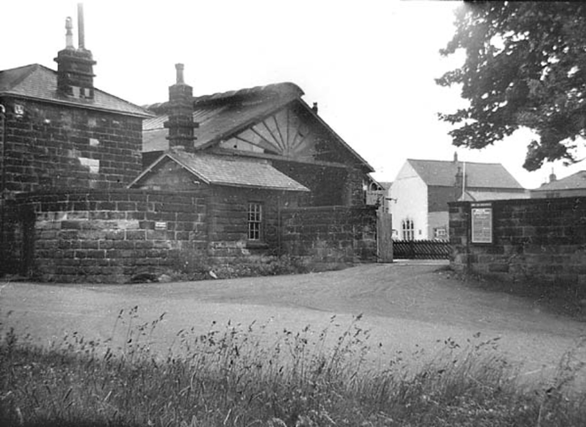 A derelict Guisborough Station after closure in the spring of 1964 - glass broken at canopy end near passenger entrance