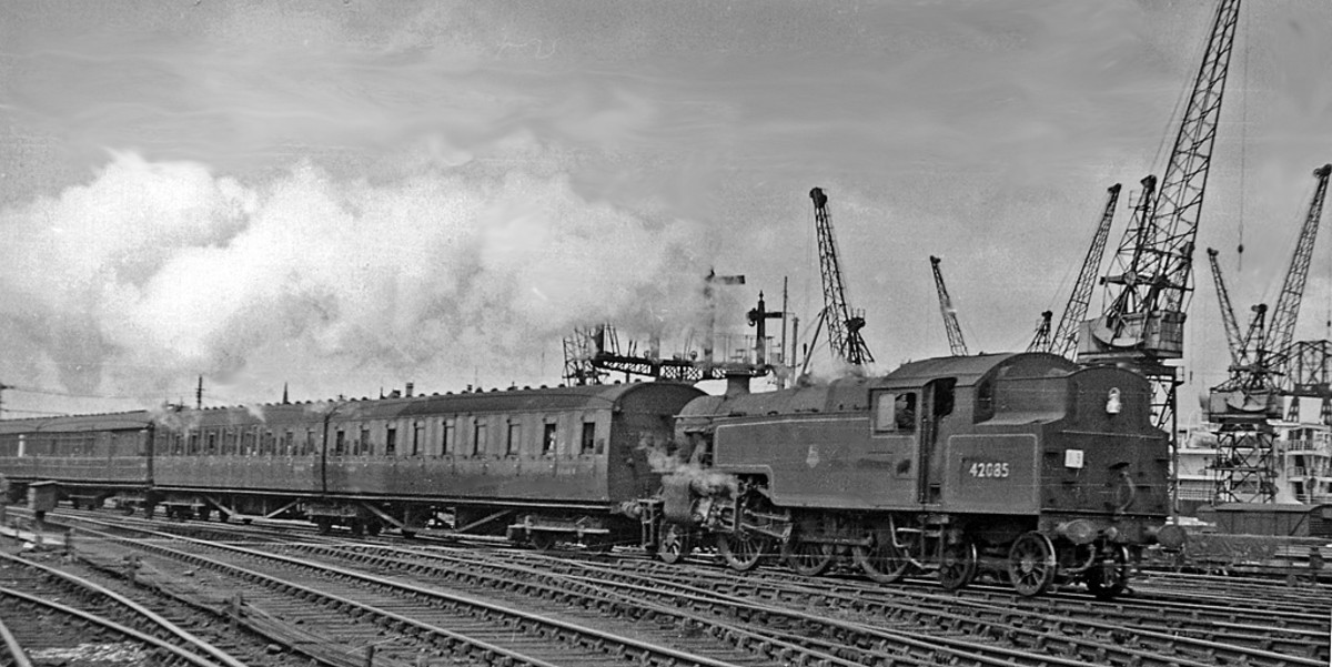 Darlington 4MT 2-6-4 Fairburn tank loco 42085 leaves Middlesbrough for Saltburn past Guisborough Junction with local stopping train. (Note dock cranes in background and steel-bodied twin-articulated coach set behind loco, Gresley teak set beyond).