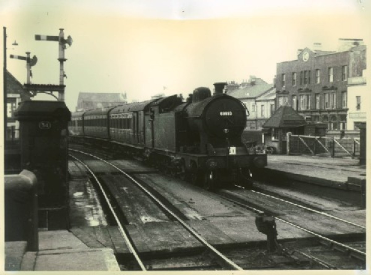 A8 4-6-2T with non-corridor stock enters Middlesbrough Station over Sussex Street level crossing from Thornaby (Darlington) direction with a train of mixed pre-1948 passenger stock. These locos were rebuilt in 1920s from Raven H1 4-4-4T