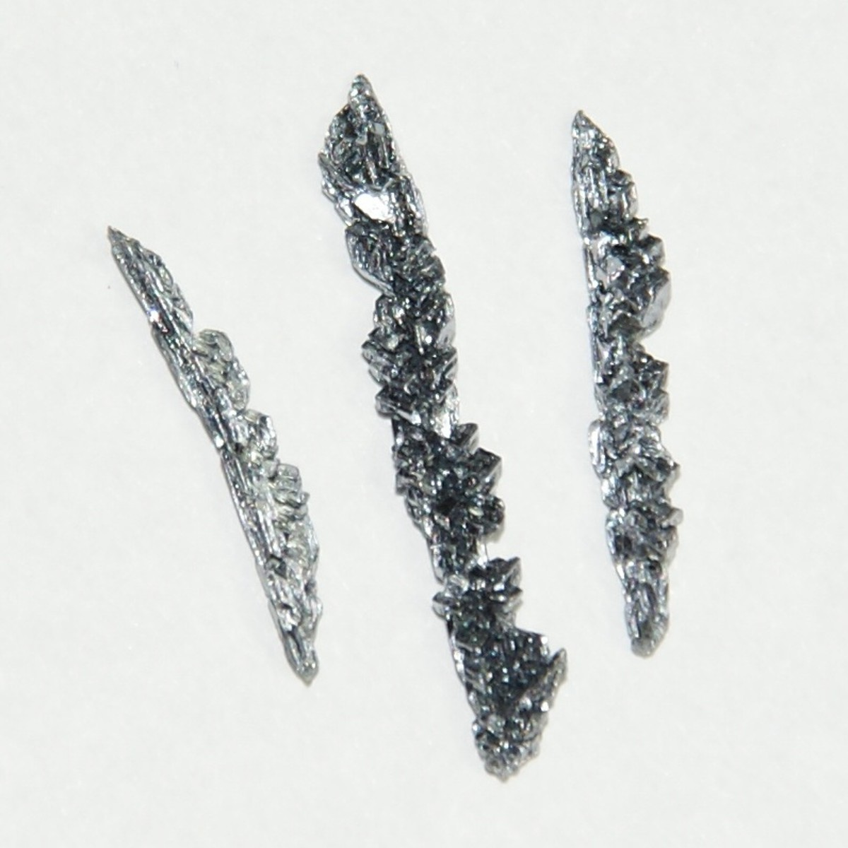 Vanadium crystals made by electrolysis, altogether 1 gram. The largest is 2 cm in length.