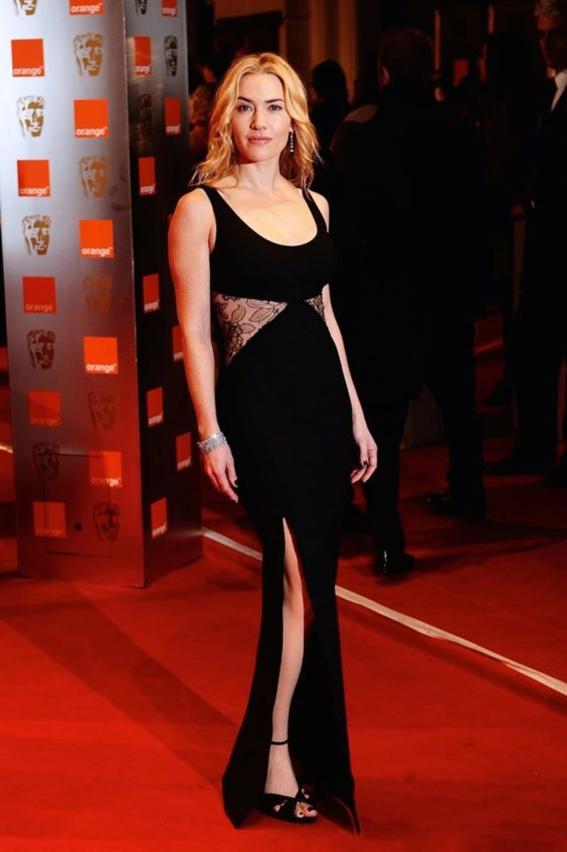 Kaye Winslet high slit black dress on red carpet for The Dressmaker