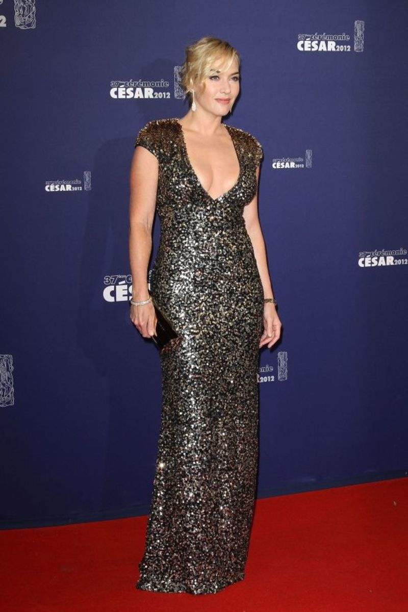 Kate in a plunging gold dress on the red carpet at the 37th Cesar Film Awards in Paris 2012
