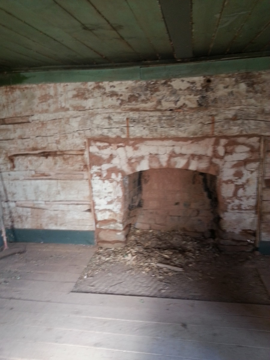 Inside the Russell Family home. View of the fireplace.