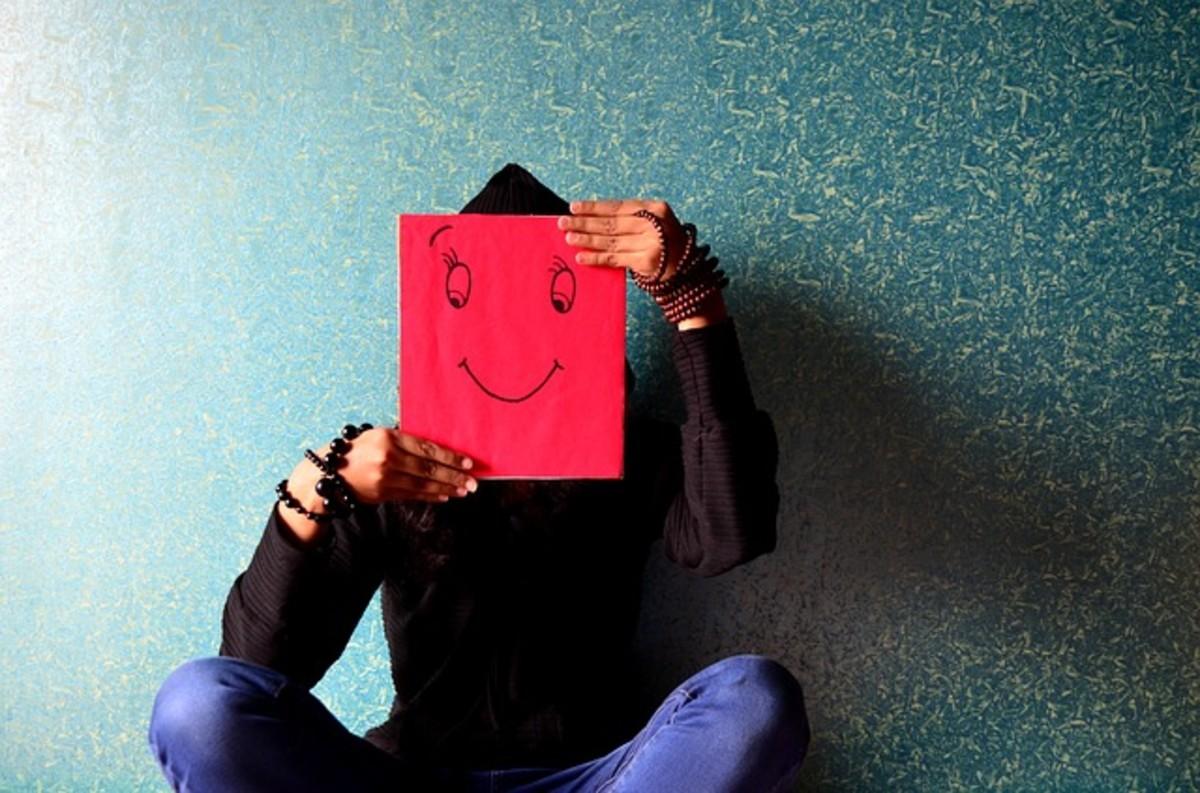 Narcissists present a false smiling face.