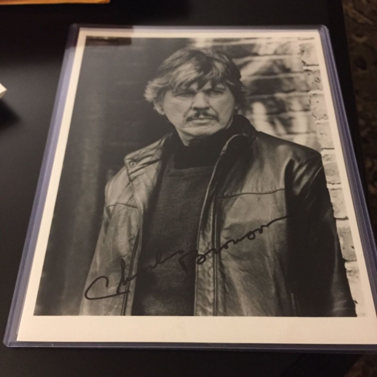 My newest addition to my collection I got at auction price.(Very pleased.) Charles Bronson is a legend known for tough spirited characters. We lost him in 2003 at the age of 81.
