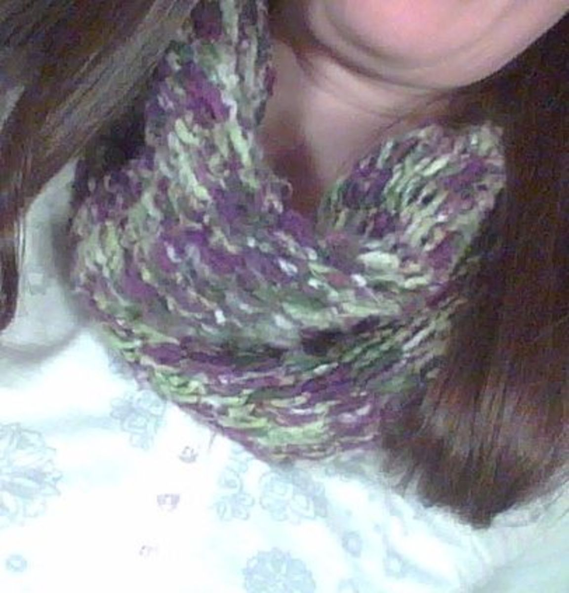 Finish the scarf by stitching the ends into the knit pattern, hiding them. The scarf is ready to wear.