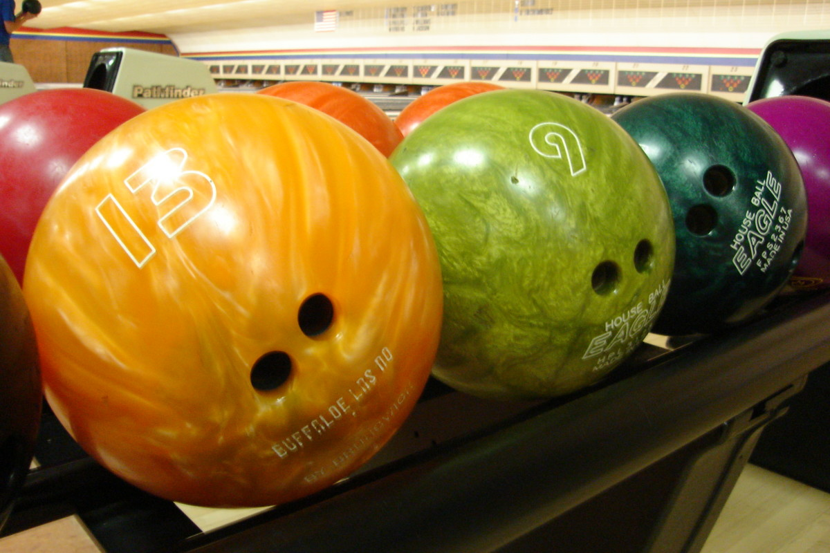 Bowling balls in attractive colors on the rack