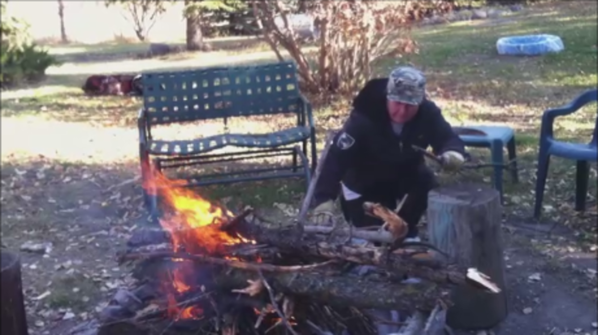 To get a large coal bed so you can cook with heat you first need to build a large fire and let it burn down.