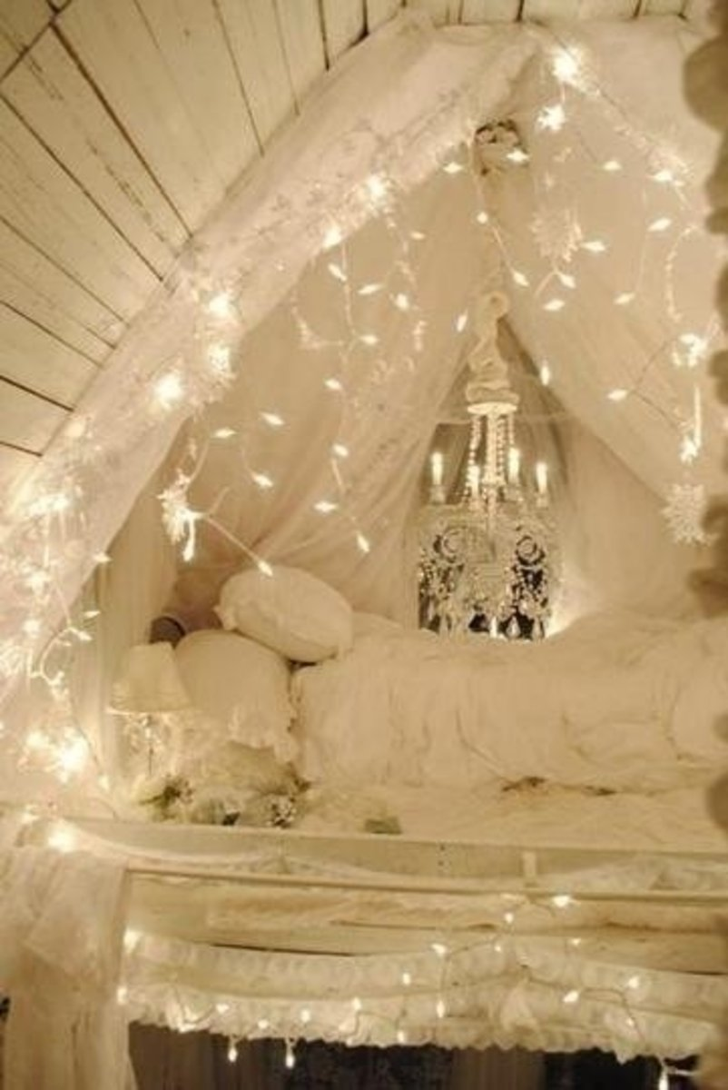 Candlelight adds a nice touch to make this a shabby chic bedroom ensemble